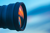 The camera lens on the background of a blue sky. close up view