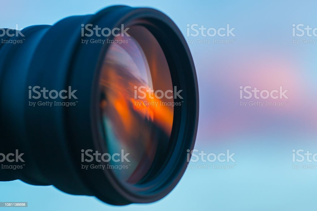 The camera lens on the background of a sky. close up view stock photo