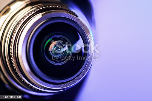 The camera lens with purple backlight. Optics. Gorizontal photo