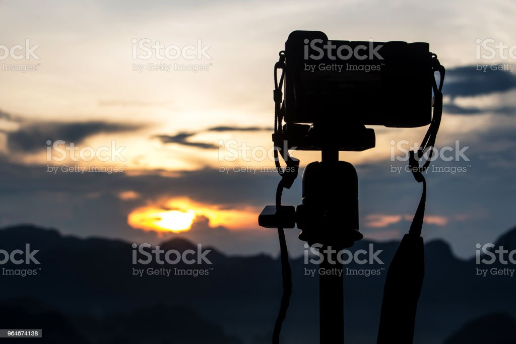 The camera on the view mountain background. silhouette picture. royalty-free stock photo