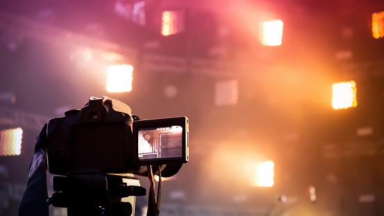 The camera shoots the concert on the background of the stage