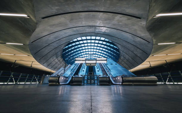 the canary wharf tube station , london - land vehicle stock photos and pictures