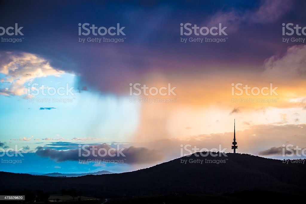 The Canberra City at dawn with mystical clouds stock photo