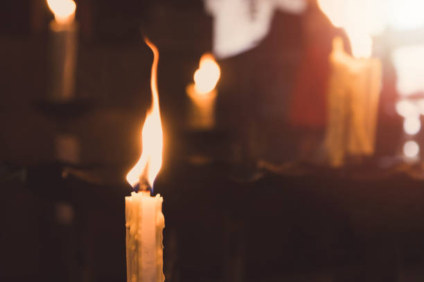 The candle was lit on the altar.Vintage tone. The candle was lit on the altar.Vintage tone. paranormal stock pictures, royalty-free photos & images