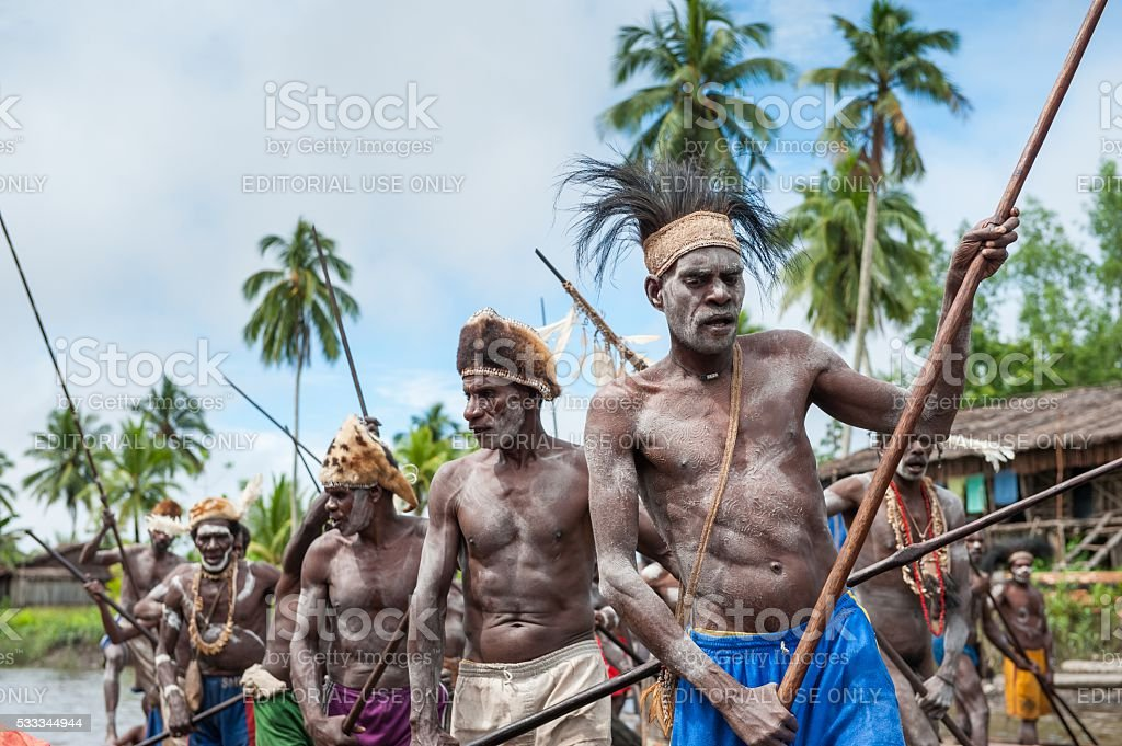 The Canoe war ceremony of Asmat people. stock photo