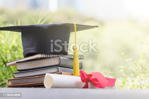 The cap put on the book and certificated in garden, Graduate education concept