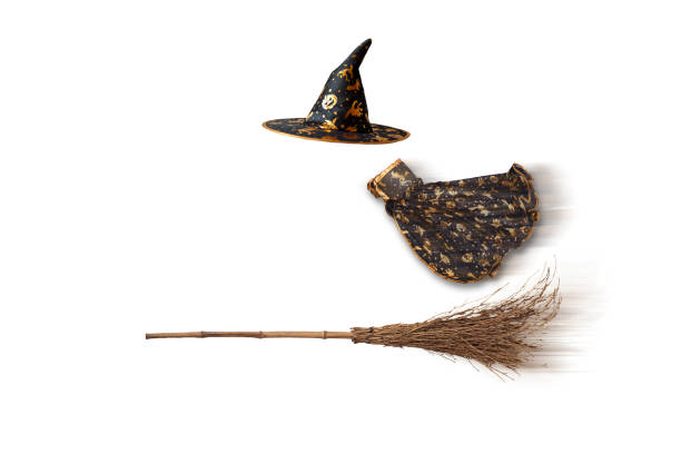 The cape, cap, broom of the Isolated witch stock photo