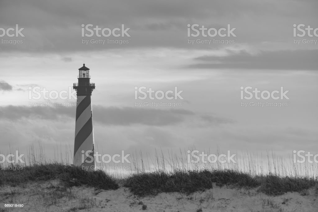 The Cape Hatteras Lighthouse on the outer Banks of North Carolina at sunset stock photo