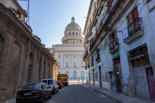 The Capitolio of La Havana seen from a street in Cuba stock photo