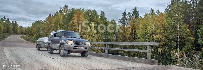 Petrozavodsk, Russia- September 5, 2019: a Toyota Land Cruiser drives on a dirt road, one of the most popular SUVs in Europe.