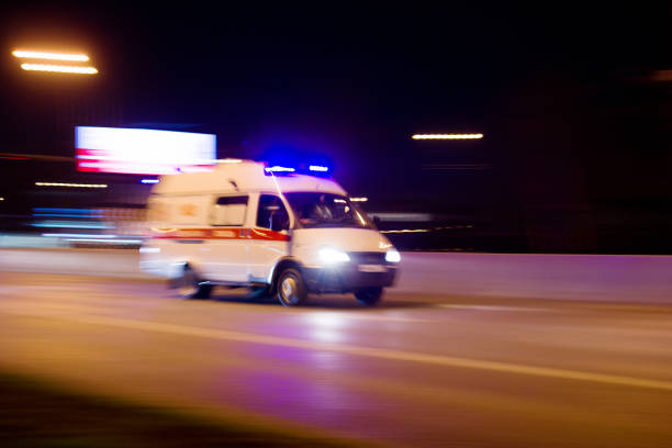 The car rushes on the highway at high speed Photo taken from the roadside ,Moscow, spring 2019, sky, ambulance, road military attack stock pictures, royalty-free photos & images