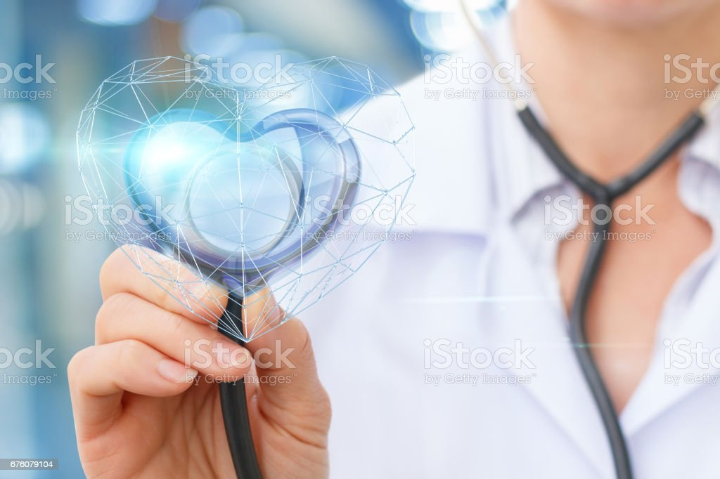 The Cardiologist listens to the heart . stock photo