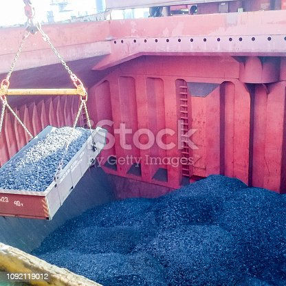 istock The cargo compartment of the ship, filled with coal. Loading of 1092119012