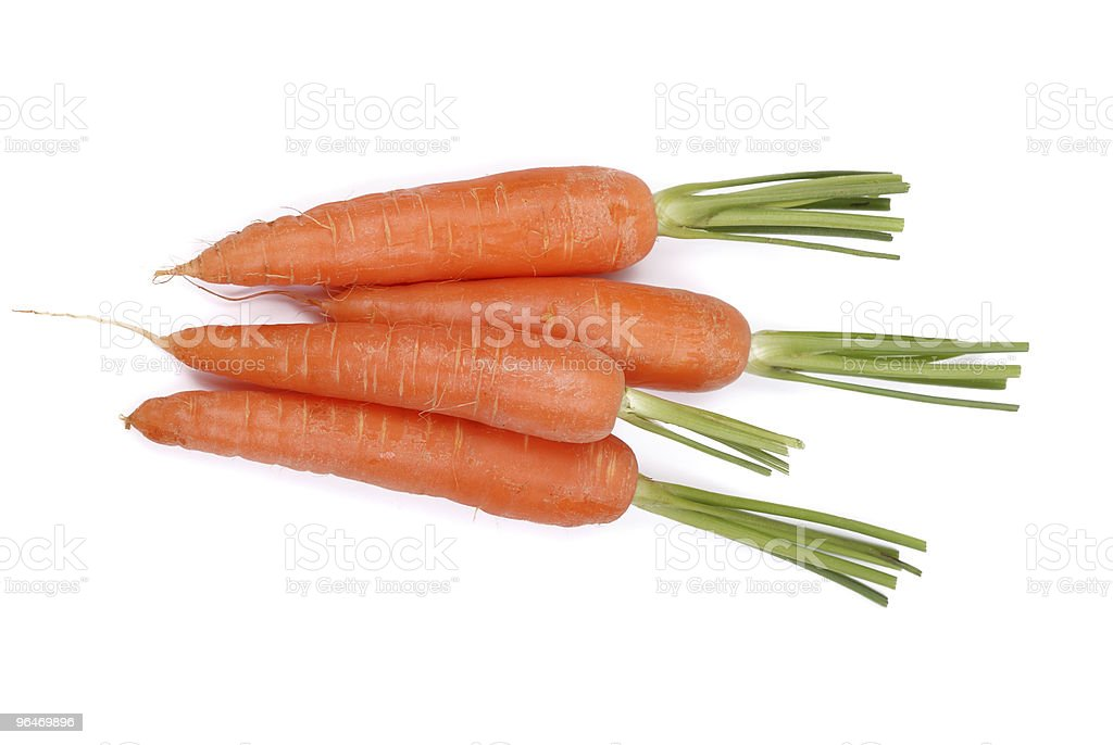 The carrots on a white royalty-free stock photo