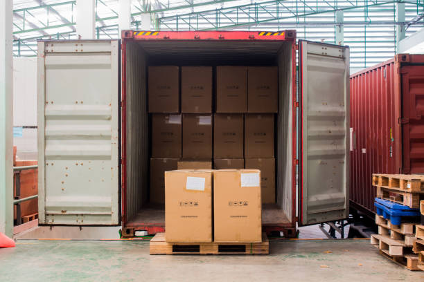 The cartons with loading out of container stock photo