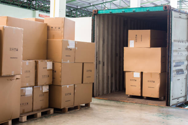the cartons with loading out of container - lorries unloading stock photos and pictures