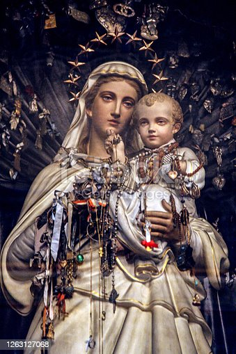 The carved polychrome statue of Madonna of Scapular with the child in church