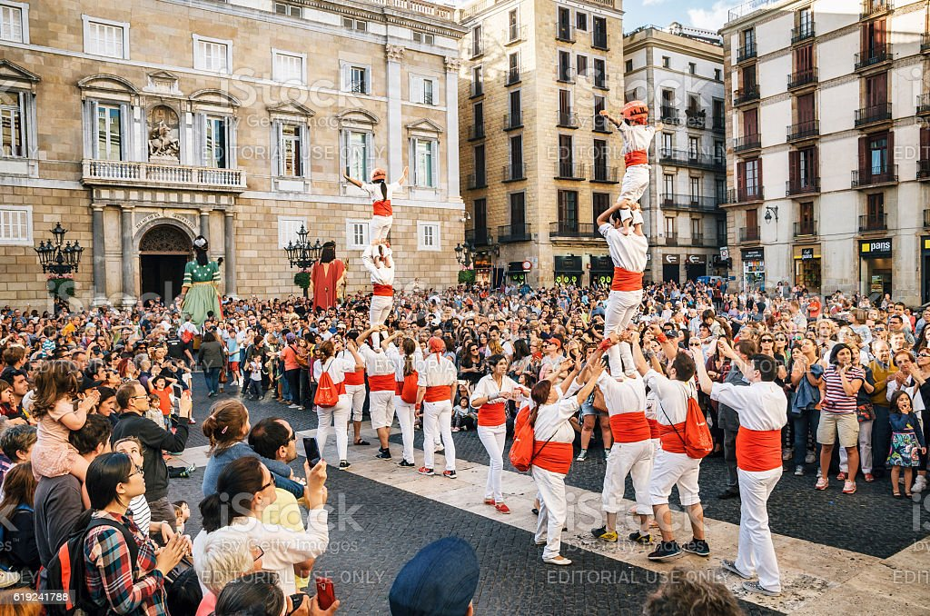 The Castellers de Barcelona and Giant puppets on Corpus Christi stock photo