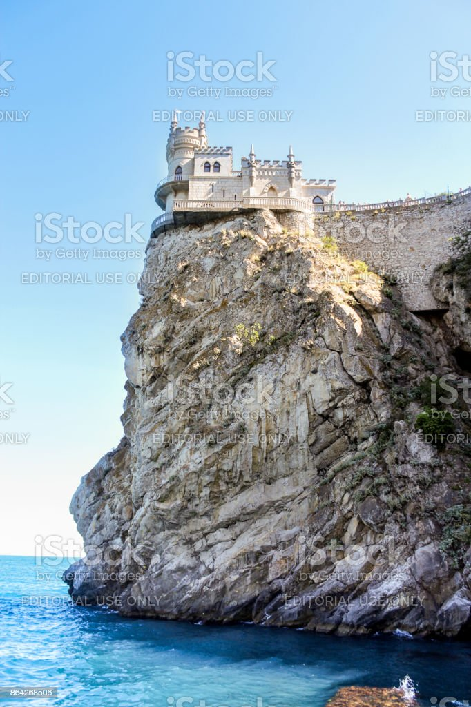 The castle is on top of a rocky cliff. royalty-free stock photo