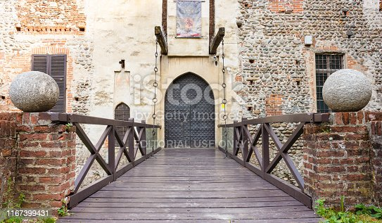 Rivarolo Canavese,Italy-June2019: Entrance with drawbridge of the castle of Malgrà .The castle was built between 1333 and 1336 by the feudatory count Martino of San Martino.