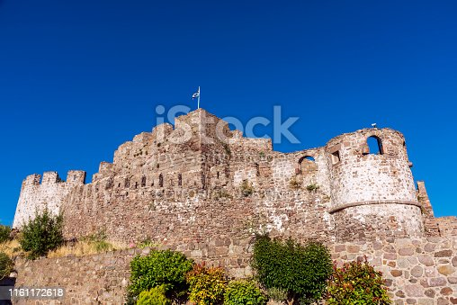 Molyvos (Mithymna) -Lesbos, June 04, 2019: The castle of Molyvos on the north part of Lesvos, in the province of Ancient Mithymna. The castle was built around 1373, during the Byzantine period, on the site of the acropolis of the ancient city, after the island of Lesvos was granted to Francesco I Gattilusio by John V Palaiologos. A few remains of the Byzantine structure are preserved in the north-west part. In addition to the extensive reconstruction by the Genoese, significant repairs and modifications were undertaken during the period of Otto-man rule (1462-1912), to which almost all the buildings preserved inside the castle belong.