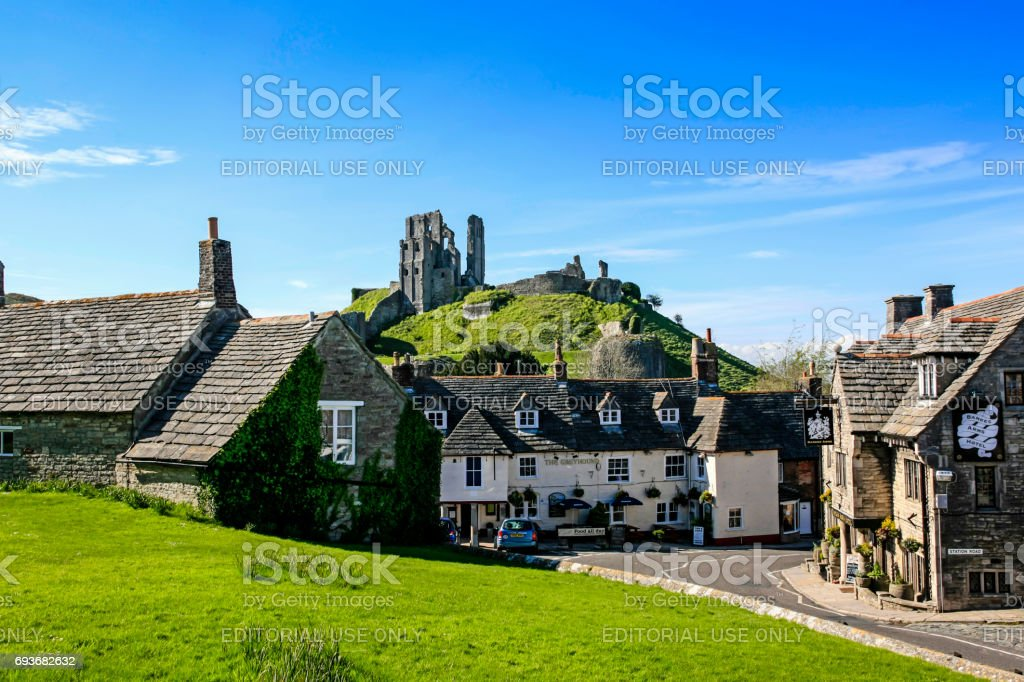 The castle ruins overlooking the village of Corfe in Dorset UK stock photo