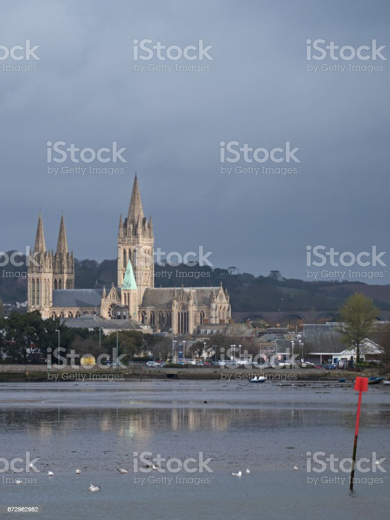 The cathedral and riverside housing in Truro city with the river tide ebbing stock photo