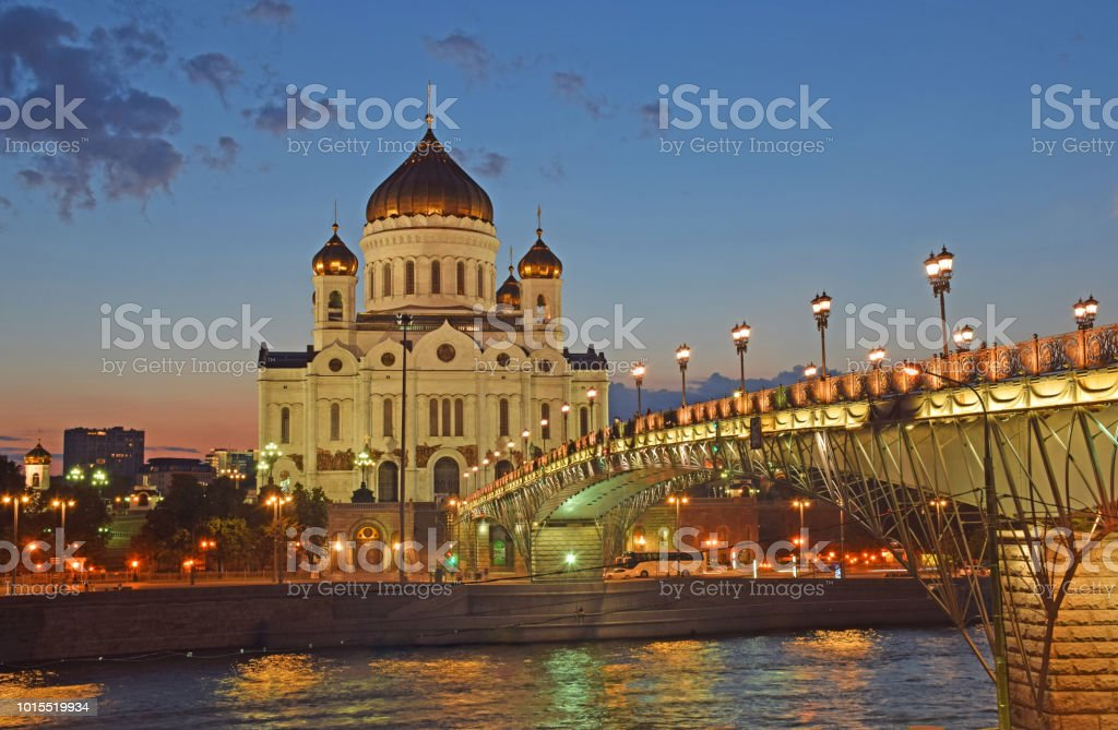 The Cathedral of Christ the Savior and the Patriarch's Bridge in the evening stock photo