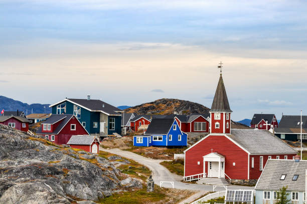 The Cathedral of Our Saviour Annaassisitta Oqaluffia and colorful houses in Nuuk. stock photo