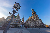Cityscape of the city of Dresden, Germany, the Katholische Hofkirche, the central church in the old town of Dresden. Historical baroque catholic  place of worship. church in the old town of Dresden. A street lamp in foreground. Tilt shift photography