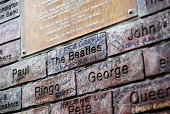 Liverpool, England - February 26, 2011: The Cavern Wall of Fame in Mathew Street, Liverpool. The Cavern Club is a rock and roll club in Liverpool, England. Opened on Wednesday 16 January 1957, the club is where The Beatles had their first performance on 9 February 1961. The cavern wall of fame shows all the bands and singers that have appeared at the famous Cavern club, Mathew street, Liverpool.