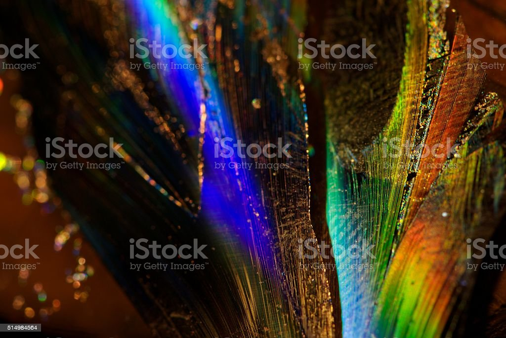 the CD's music was bad, but the broken pieces redeem close up of shards of a CD Abstract Stock Photo