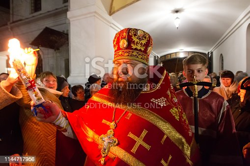 istock The celebration of Orthodox Easter. The priest carries a candle with Holy fire 1144717956