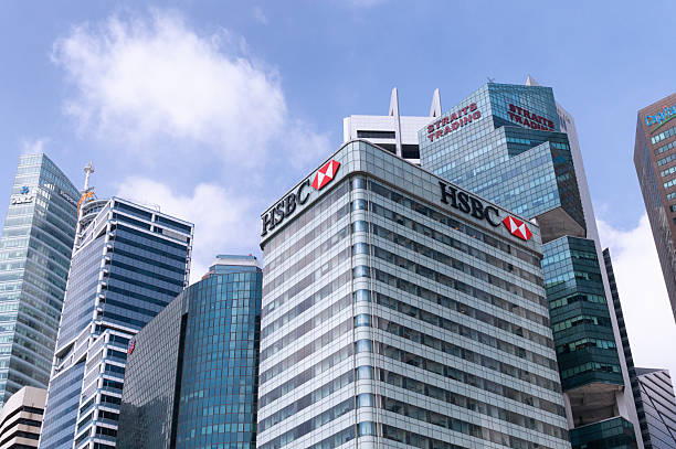 The Central Business District - Singapore Singapore City, Republic of Singapore - March 20, 2014: The Central Business District. In the foreground is the HSBC building at 21 Collyer Quay. hsbc stock pictures, royalty-free photos & images