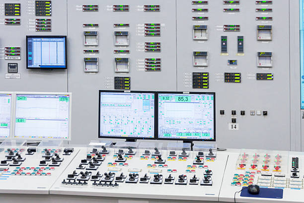 the central control room of nuclear power plant. - tableau de commande photos et images de collection