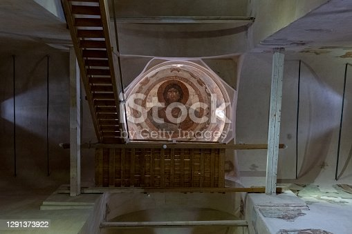 istock The central part of the Church of the Transfiguration of the Savior (Veliky Novgorod, Russia) Christ Pantokrator, painting of the dome, stairs up to the gallery 1291373922