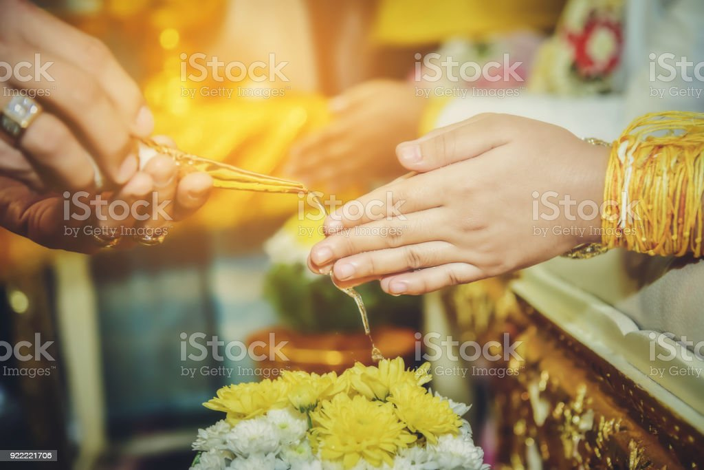 The ceremony of pouring water is one of the traditional Thai wedding. stock photo