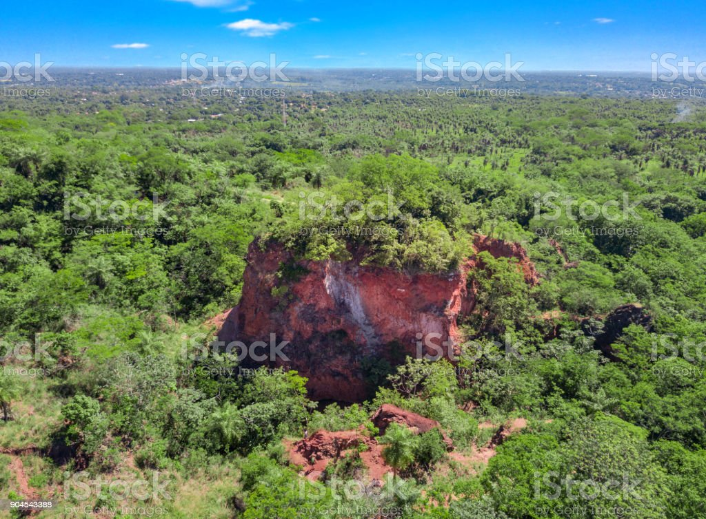 The 'Cerro Koi' a mountain of red rock near Aregua in Paraguay. stock photo