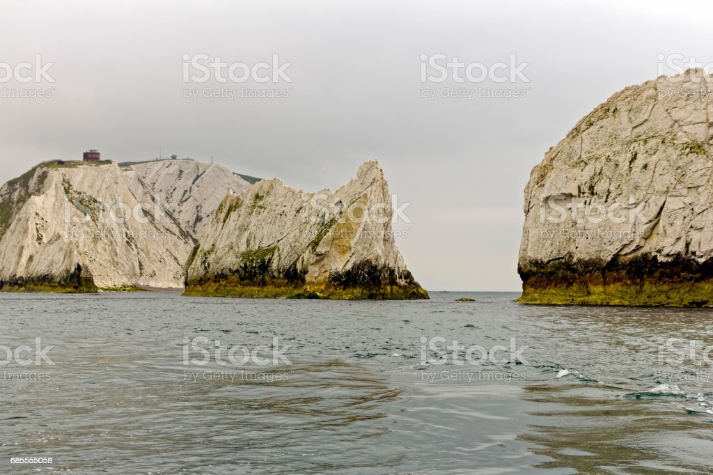 The chalk cliffs of High Down, Isle of Wight, viewed from the sea. stock photo