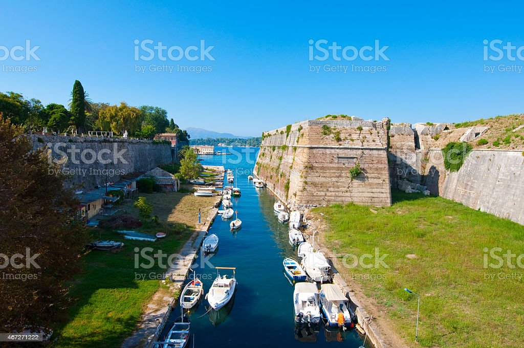 The channel separates the Old Fortress from Corfu. Greece. stock photo