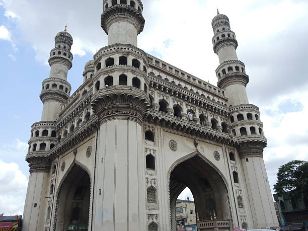 The Charminar - Hyderabad Most important and characteristic monument of Hyderabad, South India. It's in the middle of a big market. char minar stock pictures, royalty-free photos & images