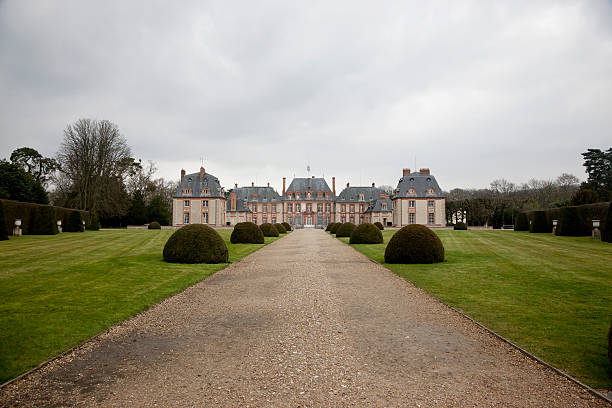 The Chateau de Breteuil in rainy day stock photo