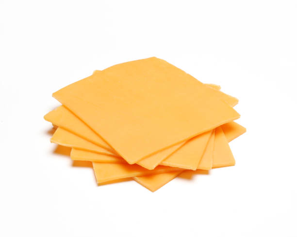 The cheddar cheese Cheddar cheese slices on white background. cheddar cheese stock pictures, royalty-free photos & images