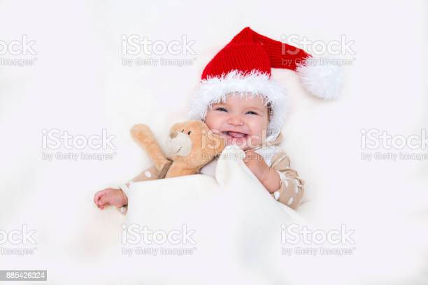The cheerful christmas baby to a santa hat and teddies bear picture id885426324?b=1&k=6&m=885426324&s=612x612&h=5l9rd69p0helmtmi9sdxvieblg4 pdljejwiki5zb6m=