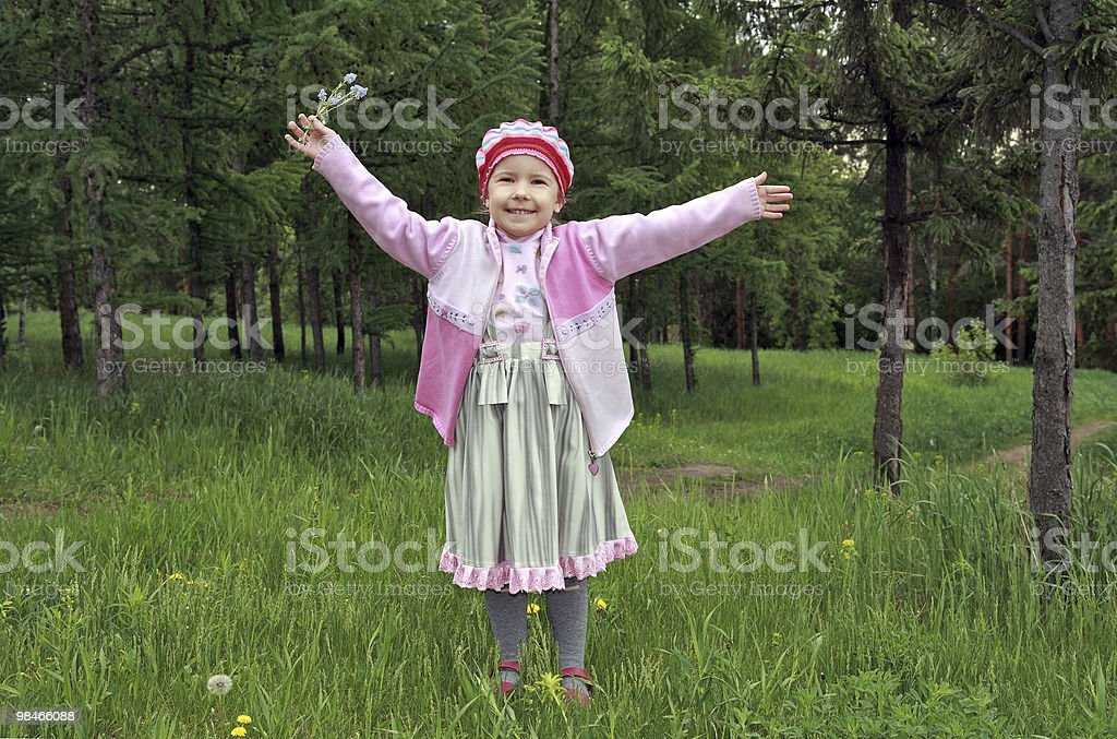The cheerful girl in park royalty-free stock photo