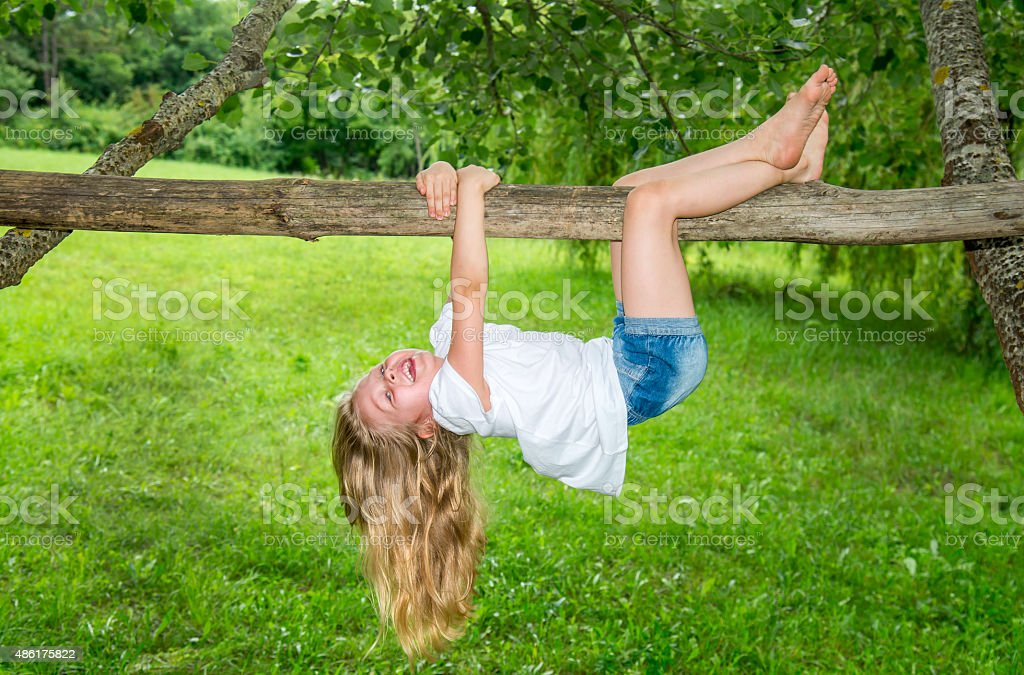 The cheerful little active girl stock photo