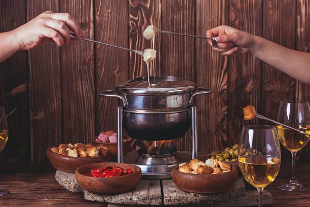 the cheese fondue - fondue zutaten stock-fotos und bilder