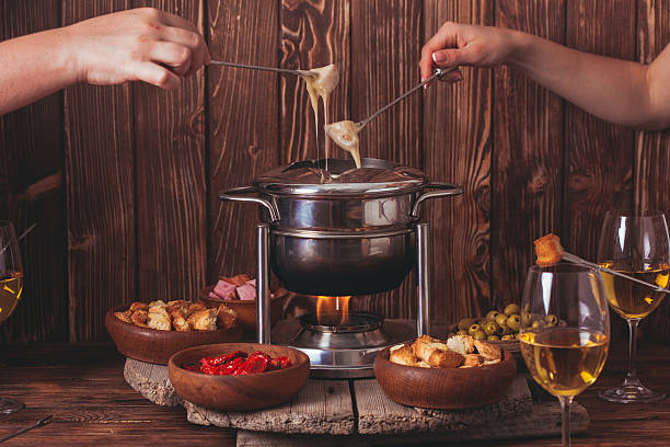 the cheese fondue - fondue stock-fotos und bilder