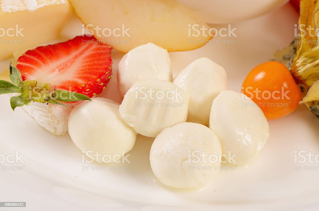 The cheese with honey and strawberries royalty-free stock photo