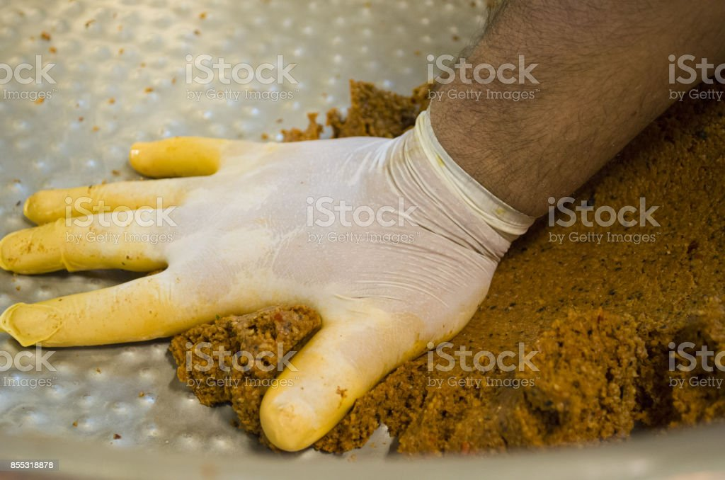 the chef is making traditional turkish food. Cigkofte cooking stock photo